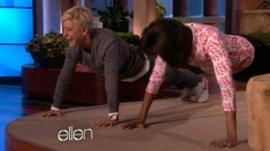 Ellen DeGeneres and Michelle Obama do push-ups
