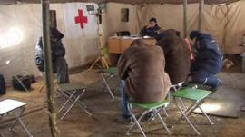 People in heated tent in Ukraine