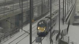 Train drives through the snow