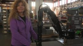 Liz Taylor with robotic arm