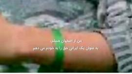 Anonymous Iranian man wearing the opposition movement's band