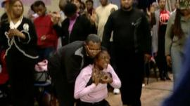 Minister in an African church dealing with woman said to be possessed