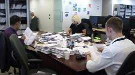 People studying paperwork