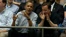 Barak Obama and David Cameron watch basketball game in Ohio.