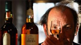 An employee at Diageo's distillery views a whisky