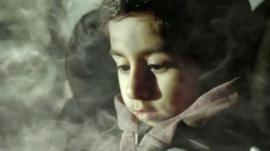 Child surrounded by cigarette smoke in car
