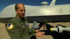 Col Ken Johnson in front of an unmanned aircraft