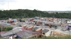 Housing springing up along the border of Manaus and the Amazon