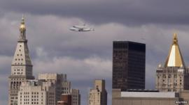 Nasa shuttle Enterprise rides on top of a modified 747 over the Manhattan skyline