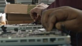 People taking apart keyboards