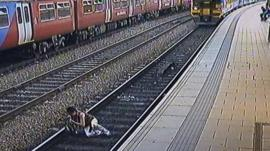 A woman stumbles in front of a train in Leeds station