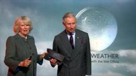 Prince Charles and Duchess of Cornwall present the weather