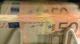 Euros being counted in a note-counting machine