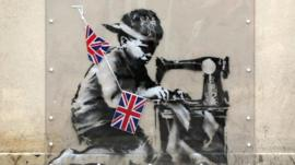 Mural on Wood Green High Road, London, by the artist Banksy