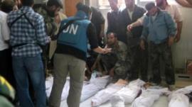 UN observers at a hospital morgue
