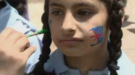 Girl's face being painted in Pakistan