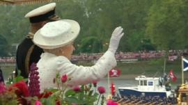 The Queen waves to crowds