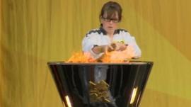 Torchbearer Louise Lyons lights the cauldron in Portrush
