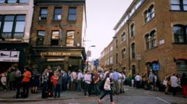 People outside a pub in Shoreditch