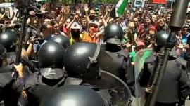 Spanish riot police and protesters