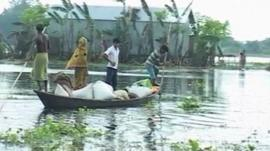 People in a boat with their belongings