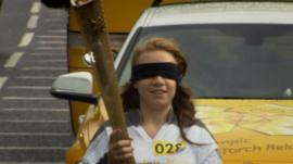 Mia Rathband carrying the Olympic torch