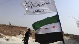 Syrian rebel and flag