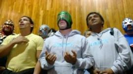 Some of the lucha libre wrestlers in church