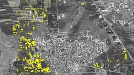 An Amnesty image allegedly showing artillery impact craters - represented with yellow dots - in Anadan, near Aleppo