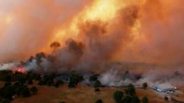 Fires rage in US