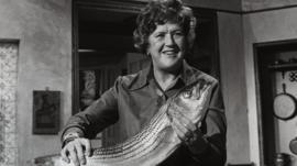 Julia Child holding a fish