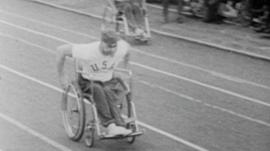 Man in wheelchair races in early Paralympic Games