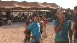 Syrians in a refugee camp