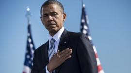 Obama places his hands on his heart