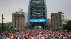 Runners cross the Tyne Bridge during the Great North Run