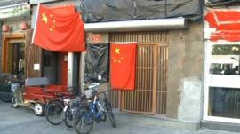 Damaged shopfront in Beijing
