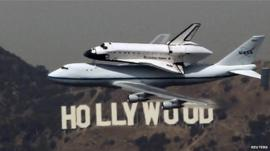 Space shuttle Endeavour flies over Hollywood sign