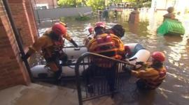 Rescue teams evacuate elderly residents' home