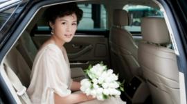 Gigi Chao on her way to the church blessing