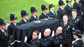 Coffin of PC Fiona Bone is carried into Manchester Cathedral