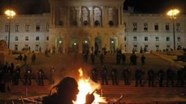 Fire burns in front of parliament in Lisbon