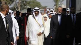 Qatari Emir Sheikh Hamad bin Khalifa al-Thani and Gaza's Hamas prime minister Ismail Haniya
