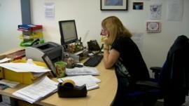Charity helpline worker