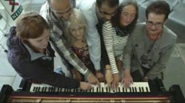 Bus passengers playing Beethoven