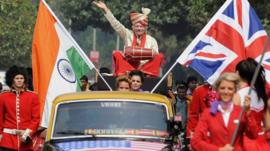 British business tycoon Richard Branson plays a traditional Indian drum during a photo opportunity parade in Mumbai