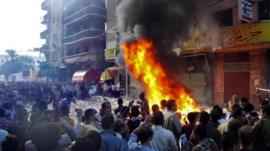 Protesters storm an office of Egyptian President Mohammed Mursi's Muslim Brotherhood party in Alexandria, 23 Nov