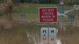 Flooding sign which says
