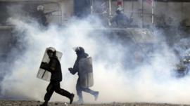 Riot police and tear gas
