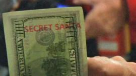 One of the specially-marked 'Secret Santa' $100 bills