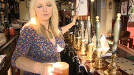 Woman pulling a pint